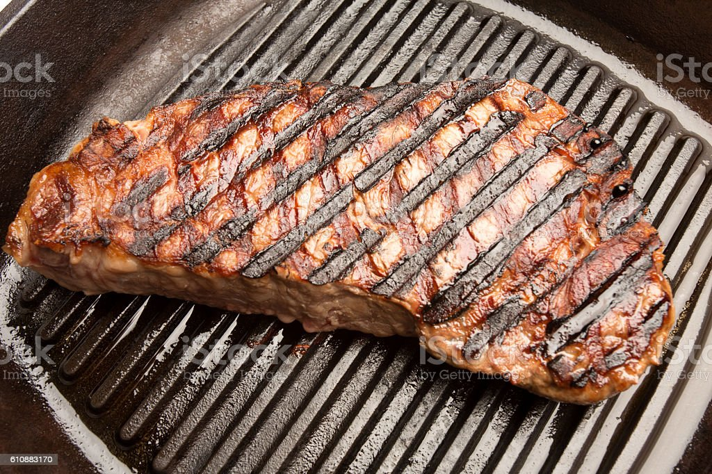 Grilled New York Steak on a Griddle stock photo