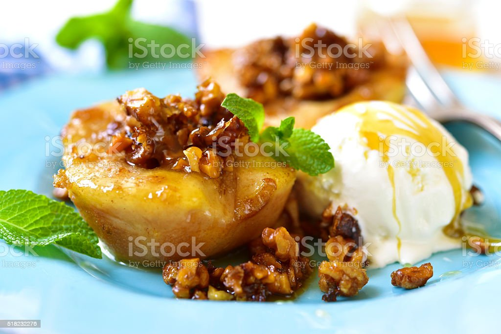 Grilled pear with caramelized walnuts and honey. stock photo