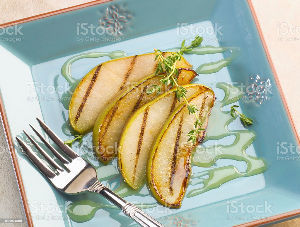 Grilled Pears with honey & thyme dessert plate stock photo