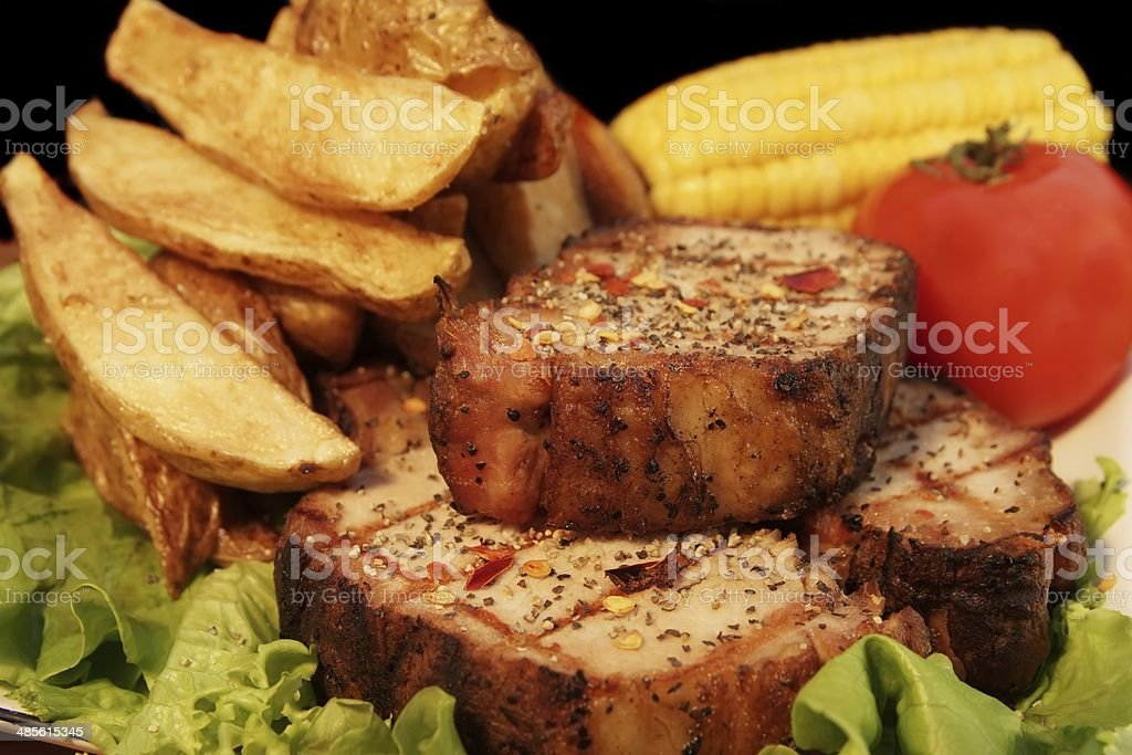 Grilled Pepper Steaks and  Wedges Potato,  XXXL stock photo