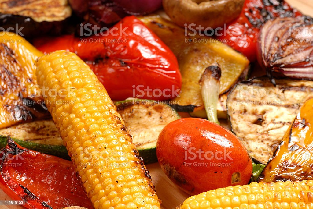 Grilled peppers, onions, corn, zucchini, eggplant and tomatoes royalty-free stock photo