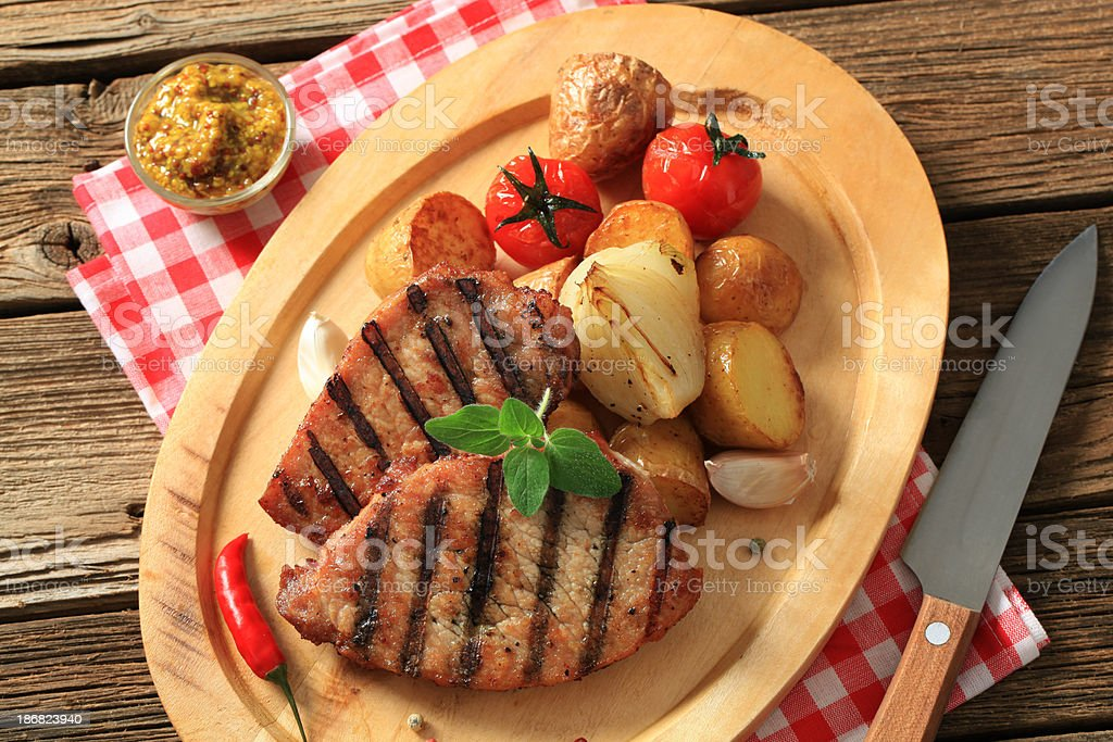 Grilled pork and roasted potatoes royalty-free stock photo