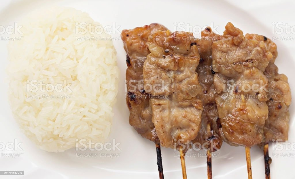 Grilled pork and sticky rice : Thai food stock photo