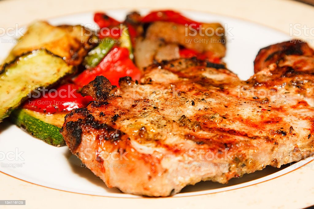 Grilled pork chop with side order of vegetables royalty-free stock photo