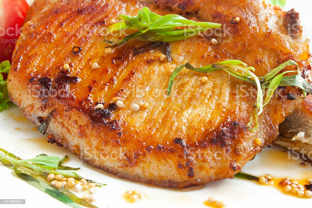 Grilled pork chop with spices royalty-free stock photo