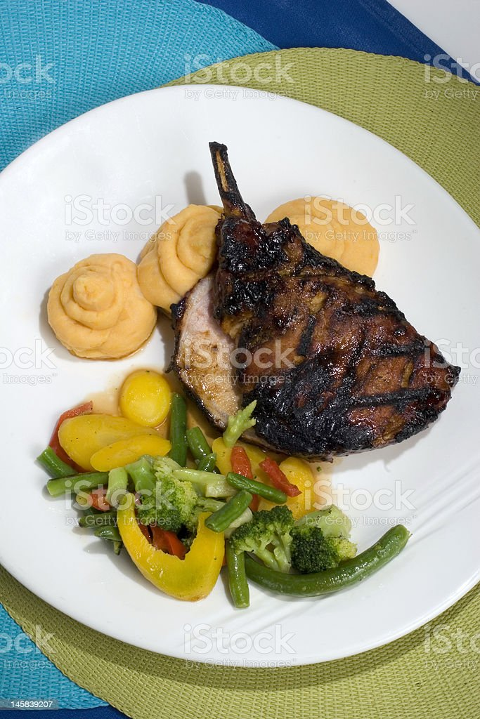 Grilled Pork Chop with Vegetables stock photo