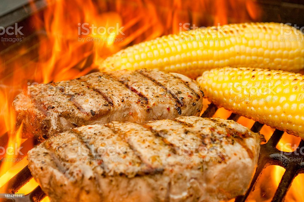 Grilled Pork Chops and Corn in Flames royalty-free stock photo