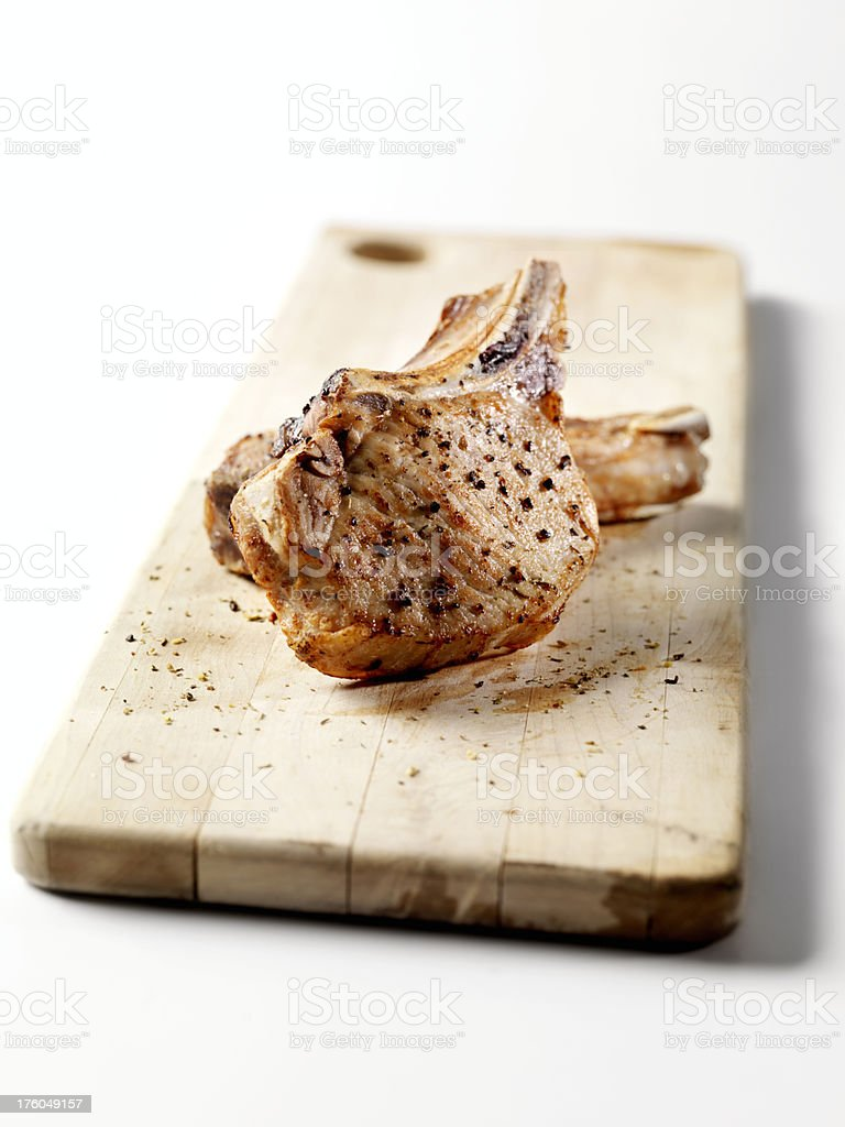 Grilled Pork Chops on a Cutting Board royalty-free stock photo