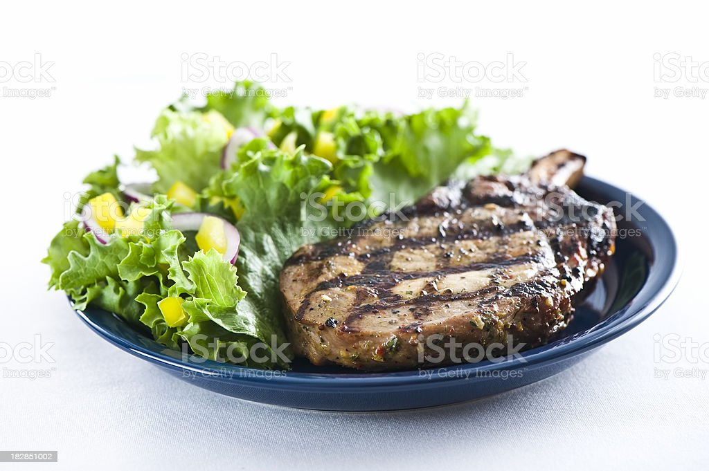 Grilled pork loin chop and salad royalty-free stock photo