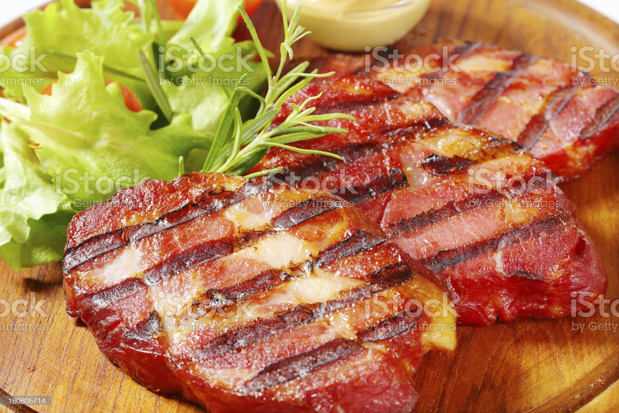 Grilled pork neck on a round cutting board royalty-free stock photo