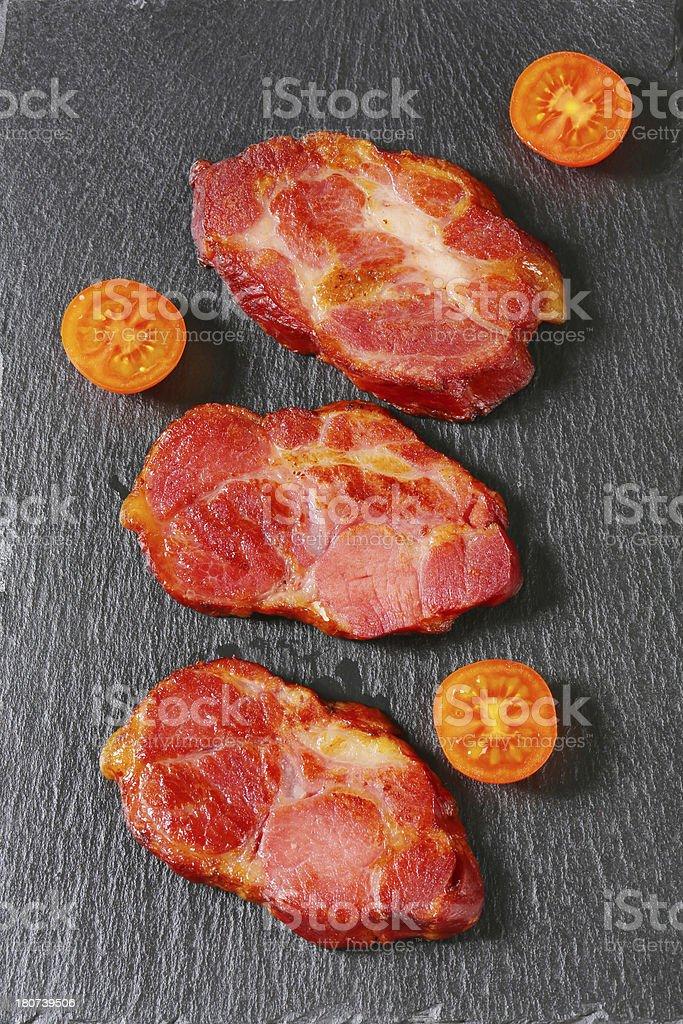 Grilled pork neck on black background royalty-free stock photo