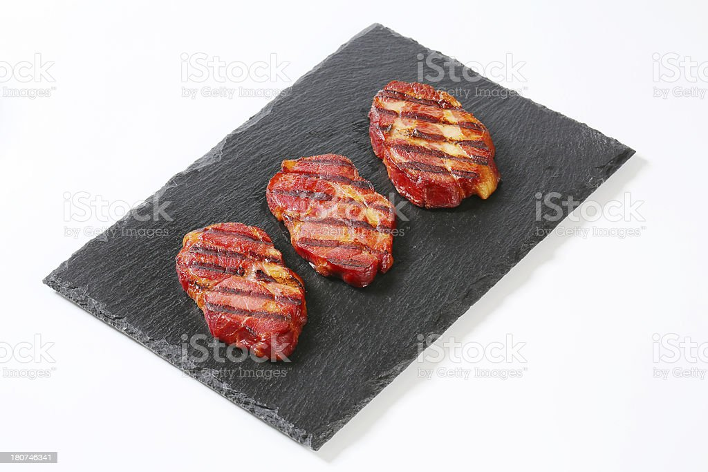 Grilled pork neck on black background royalty-free stock photo