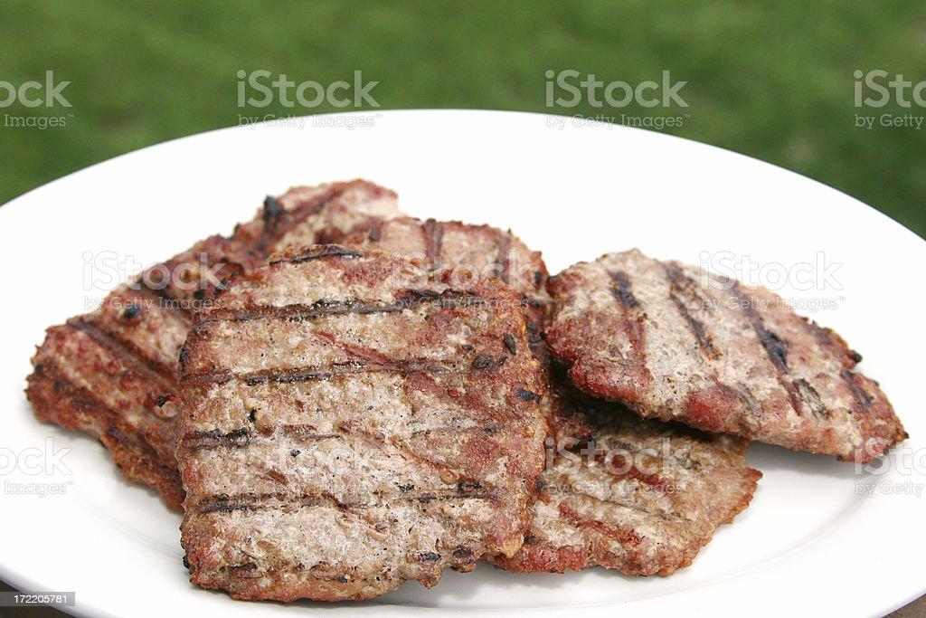 Grilled Pork Patties on White Platter stock photo