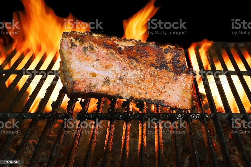 BBQ Grilled Pork Ribs On Flaming Grill stock photo