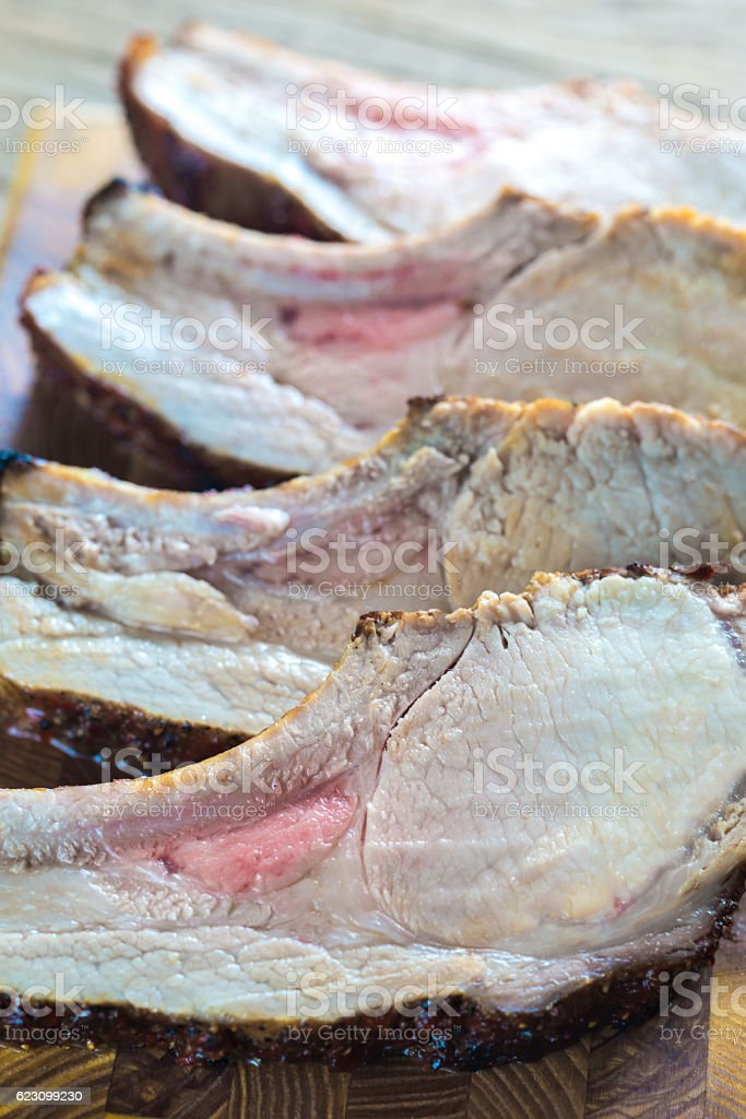 Grilled pork ribs on the wooden board stock photo