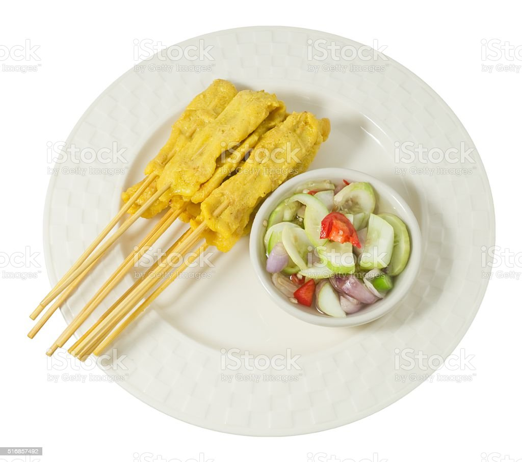 Grilled Pork Satay with Cucumber Salad on A Plate stock photo