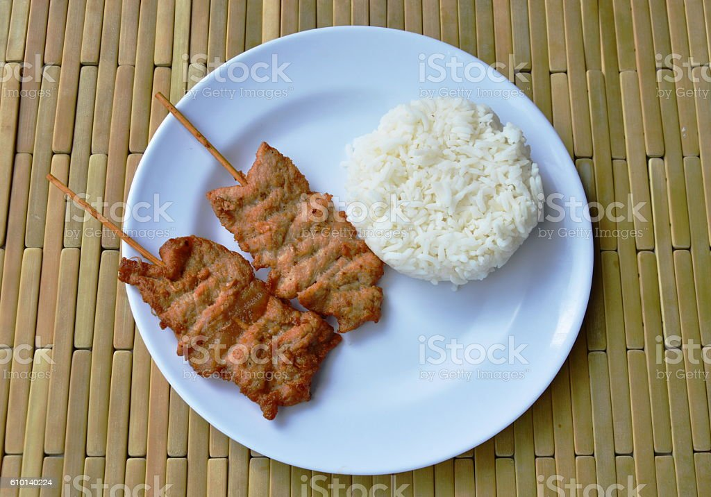 grilled pork stab in wooden stick eat couple with rice stock photo