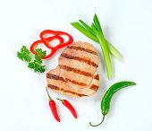 grilled pork steak with herbs