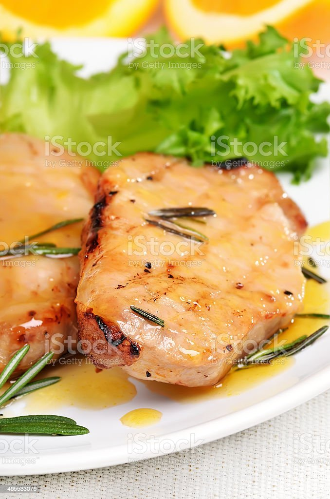 Grilled pork steak with orange sauce stock photo