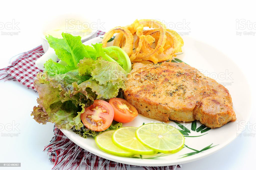 grilled pork steak with vegetable on plate (Style Still Life) stock photo