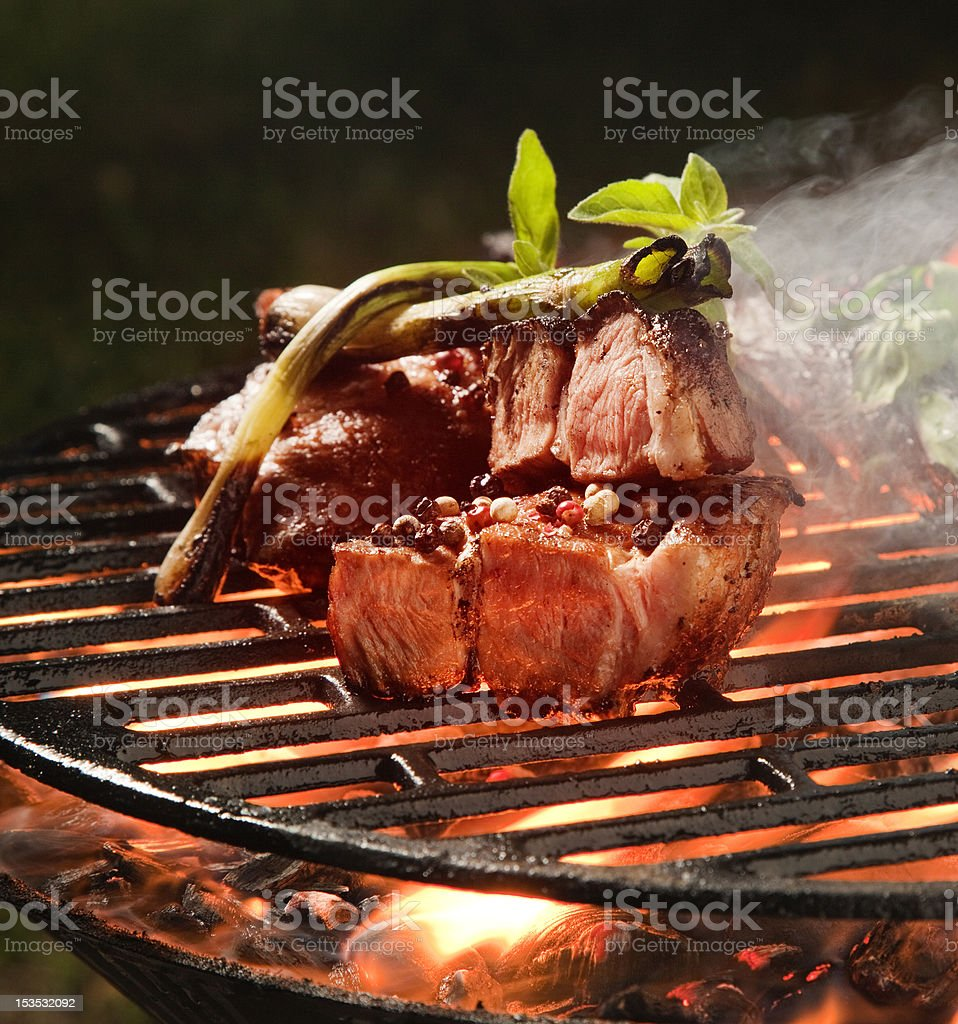 Grilled pork steaks on a grill royalty-free stock photo