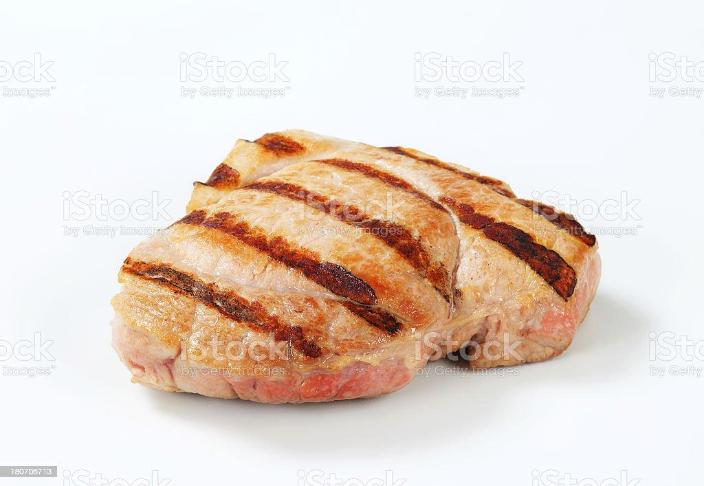 grilled pork steaks stock photo