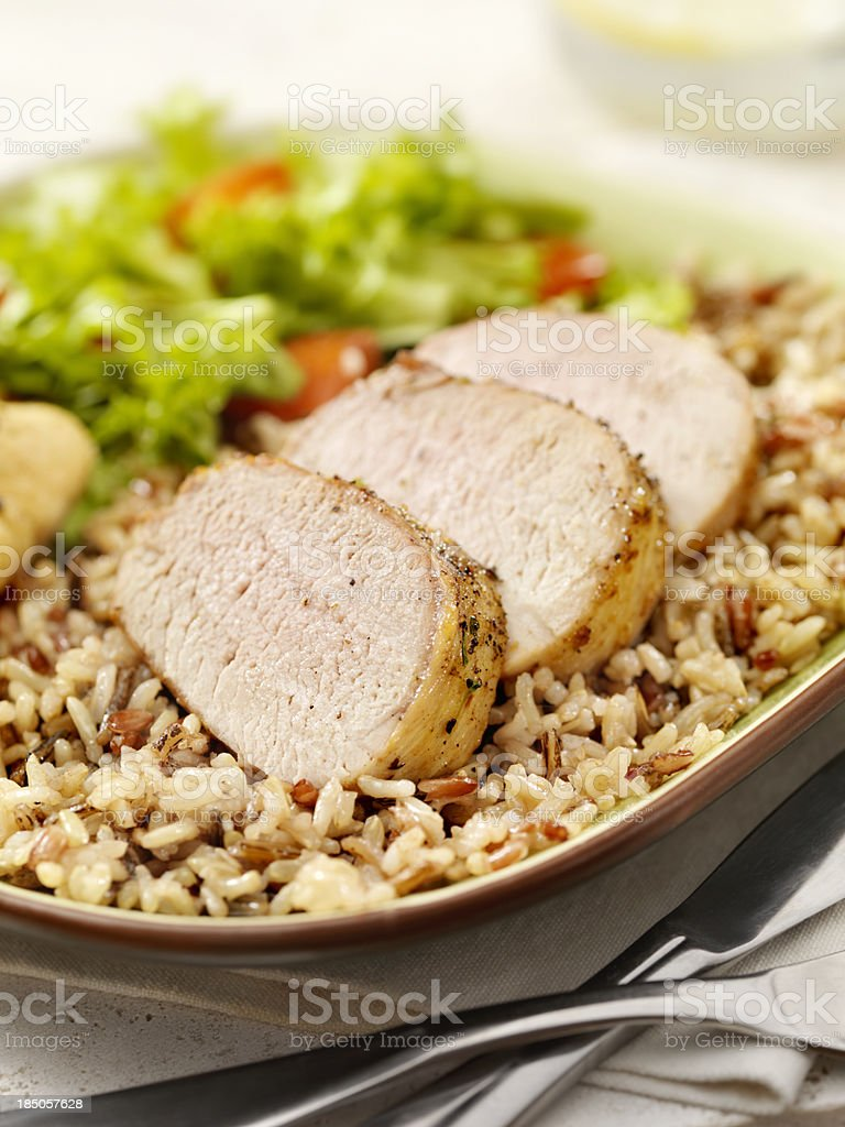Grilled Pork Tenderloin with Wild Rice royalty-free stock photo