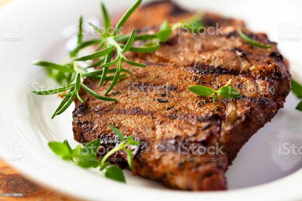 Grilled pork with fresh herbs stock photo