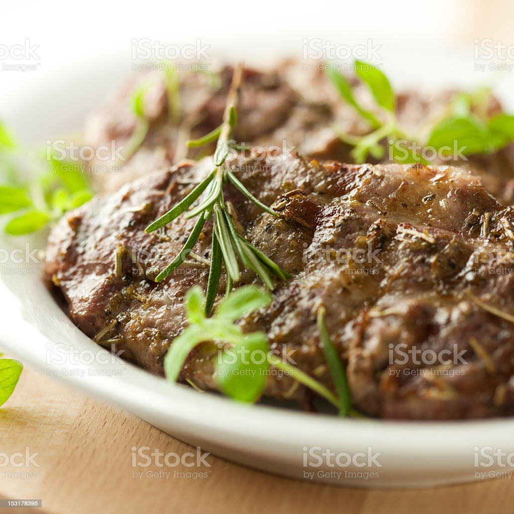 Grilled pork with fresh herbs royalty-free stock photo