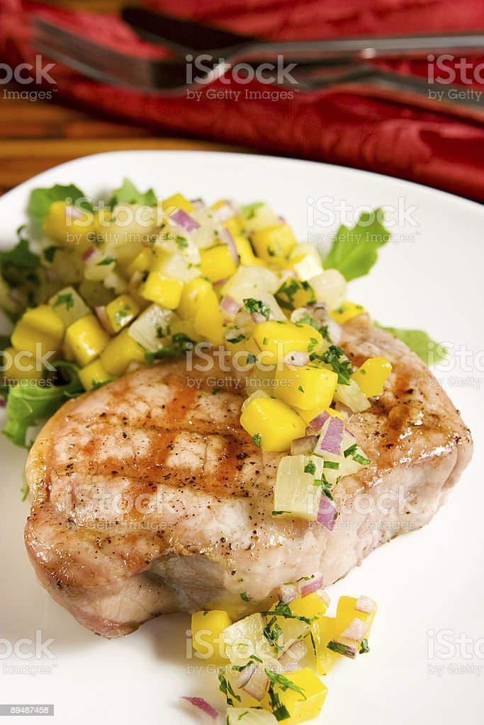 Grilled pork with tropical salsa royalty-free stock photo