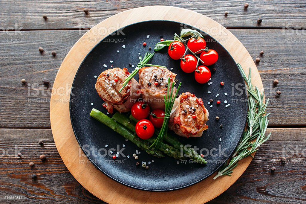Grilled pork with vegetables and spices stock photo