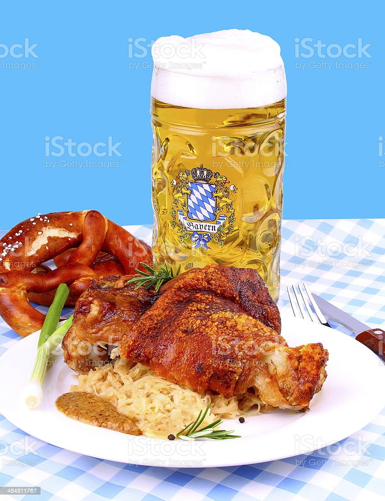 Grilled pork with whitish, sweet mustard, pretzels and beer royalty-free stock photo