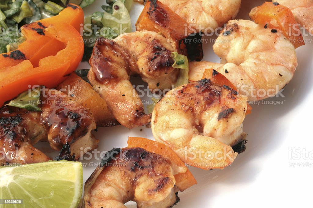 Grilled prawns on bamboo sticks royalty-free stock photo