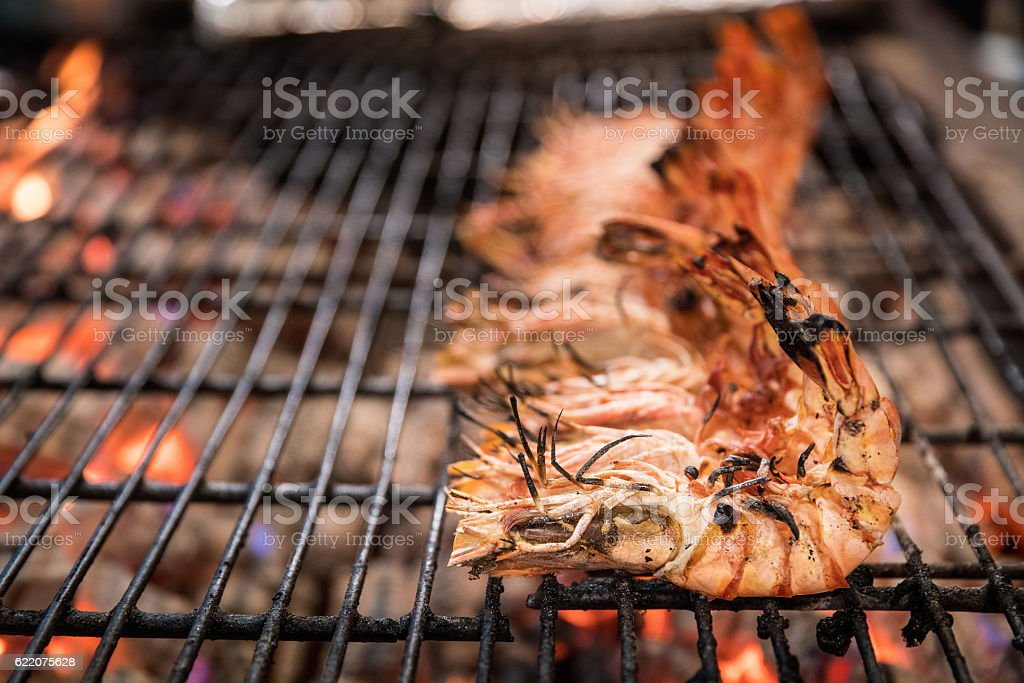 Grilled prawns on flaming grill. stock photo