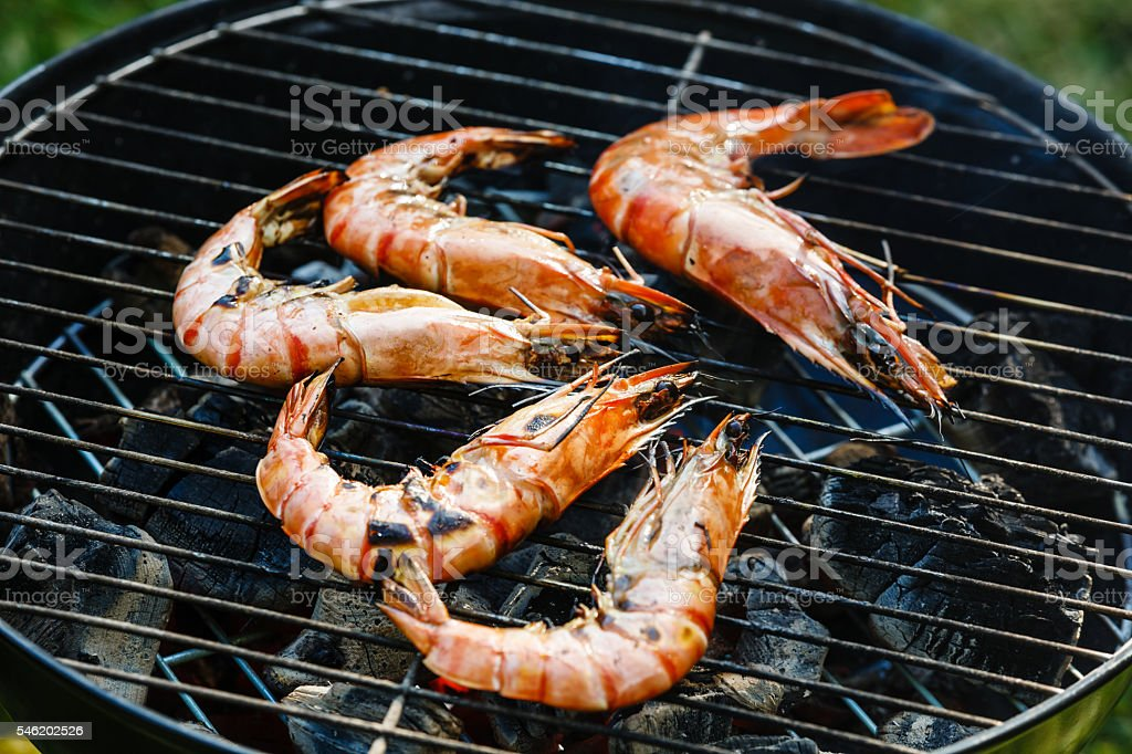 Grilled Prawns on grill BBQ background stock photo