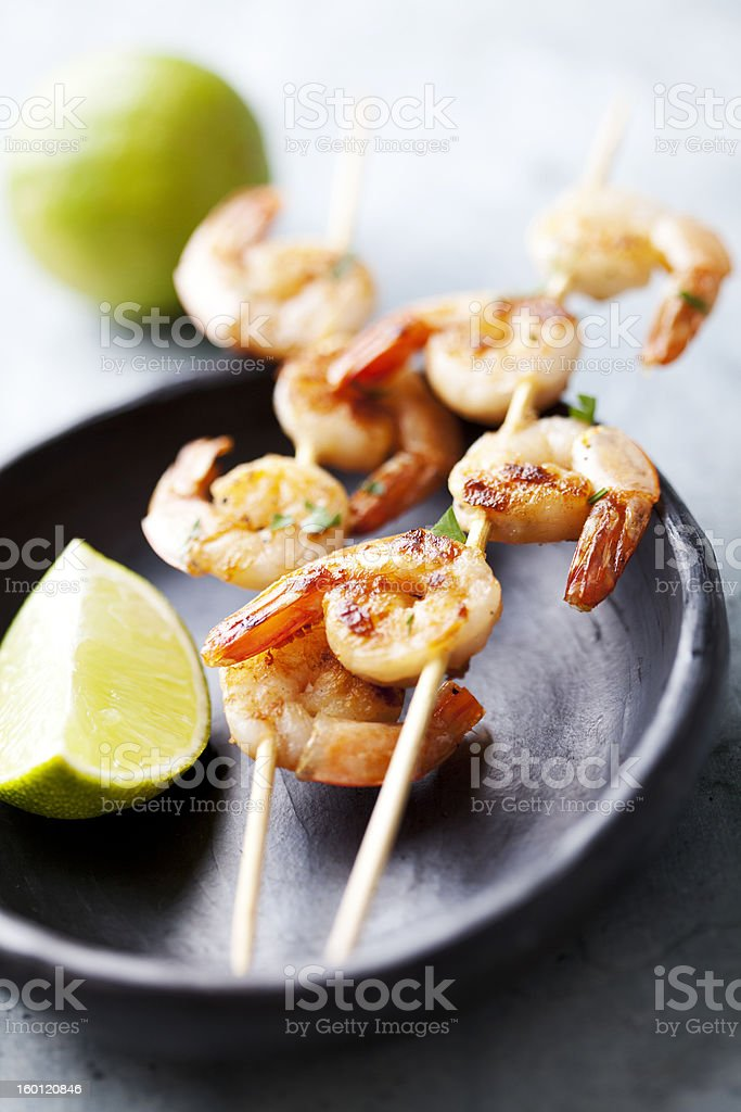 grilled prawns on skewer stock photo