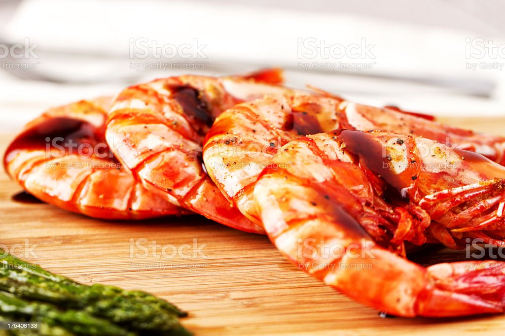 Grilled prawns with asparagus royalty-free stock photo