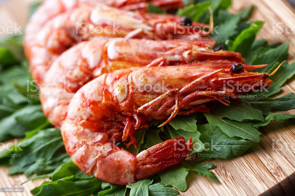 Grilled prawns with rocket salad stock photo