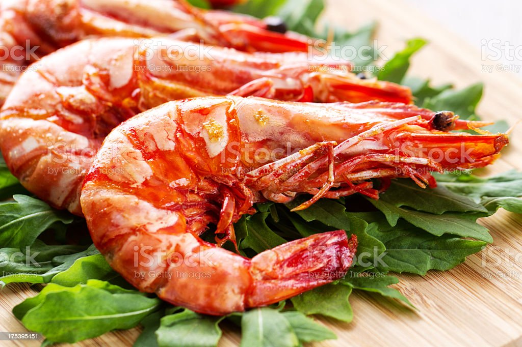 Grilled prawns with rocket salad royalty-free stock photo