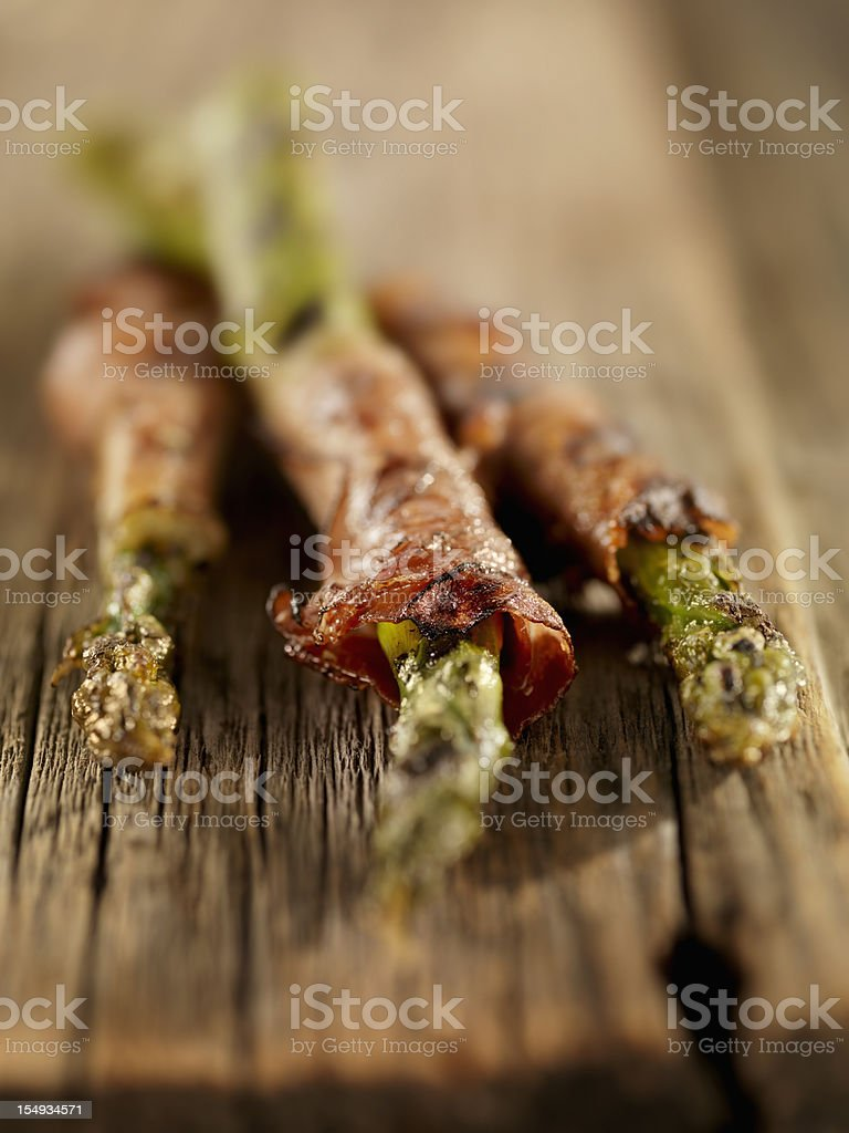 Grilled Prosciutto Wrapped Asparagus royalty-free stock photo