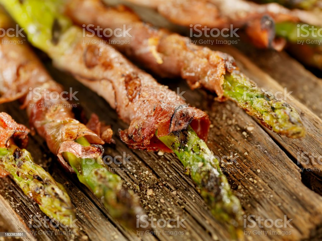 Grilled Prosciutto Wrapped Asparagus stock photo