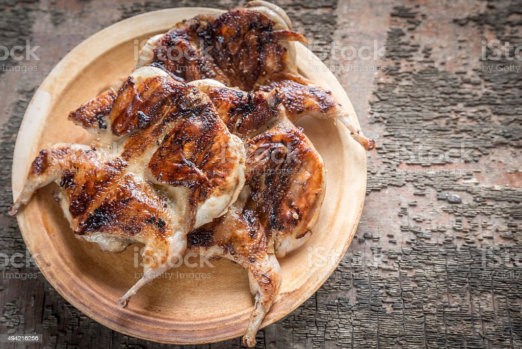 Grilled quails stock photo