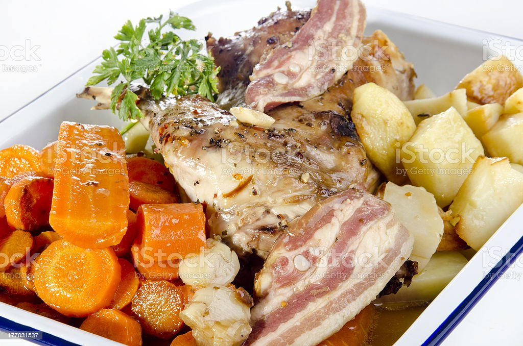 grilled rabbit with bacon, carrot and potatoes royalty-free stock photo