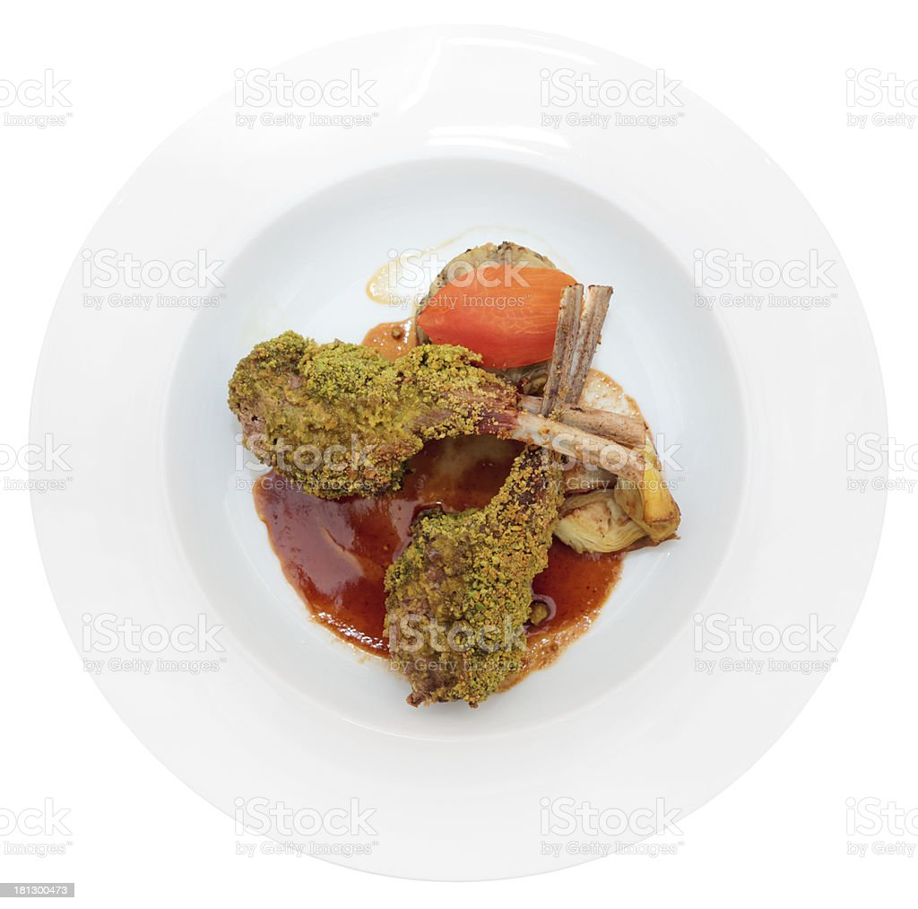 Grilled rack of lamb with pistachio in plate, isolated royalty-free stock photo