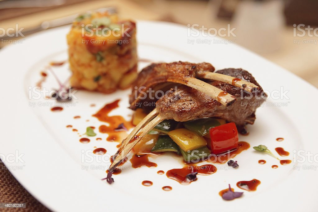 Grilled rack of lamb with potatoes and vegetables stock photo