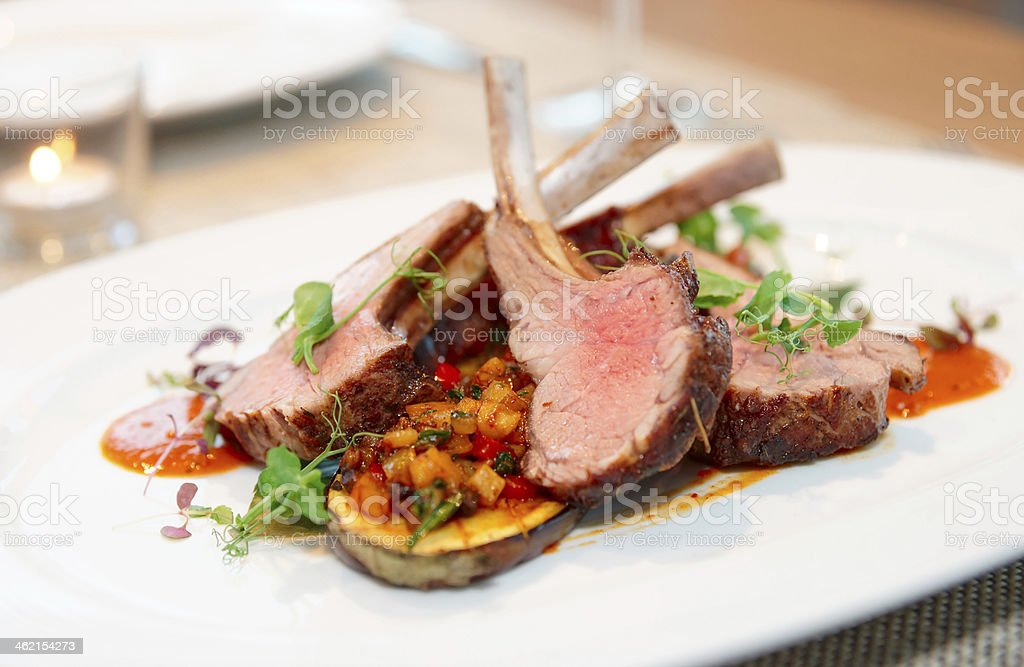 Grilled rack of lamb with vegetables royalty-free stock photo