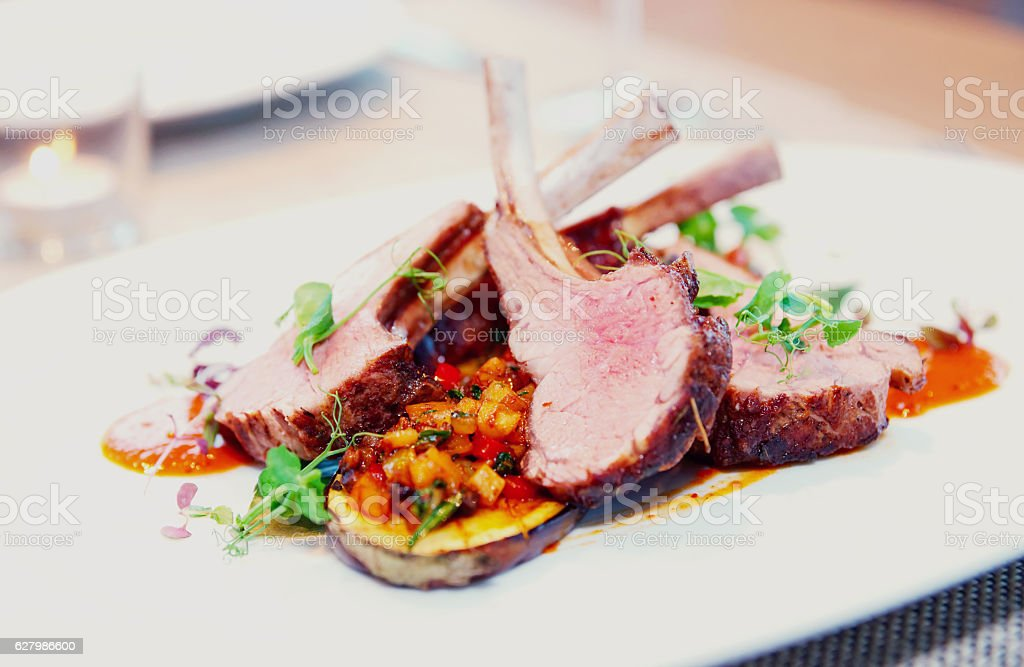 Grilled rack of lamb with vegetables, toned stock photo