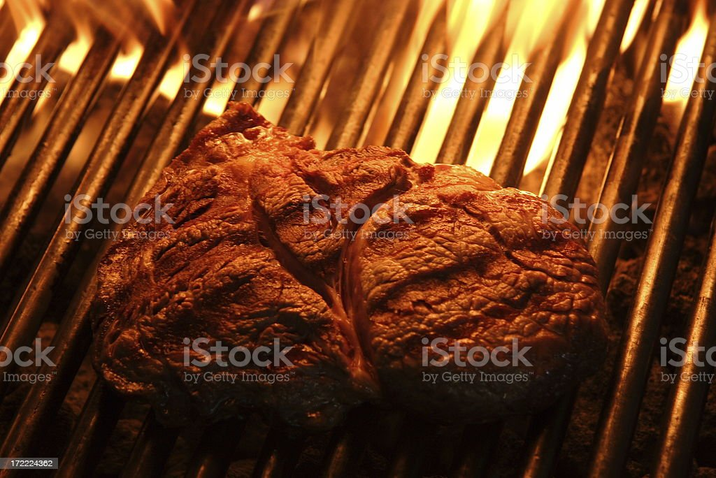 Grilled Ribeye steak and fire royalty-free stock photo