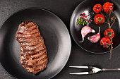 Grilled Ribeye steak entrecote on black stone background