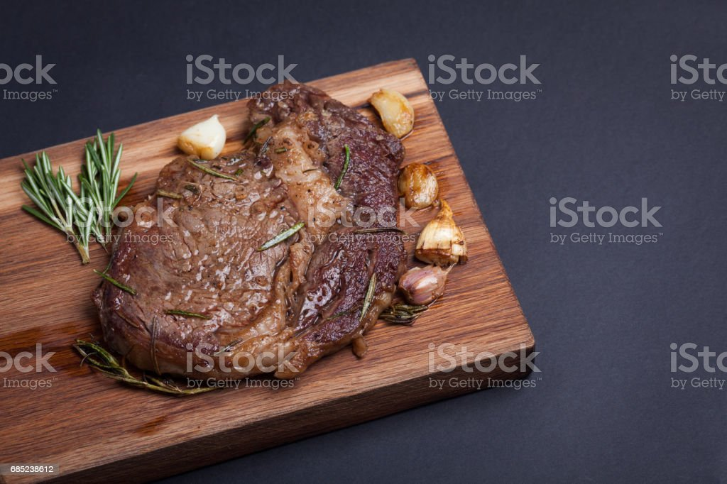 Grilled ribeye steak of marble beef with spices on wooden Board. With copy space stock photo